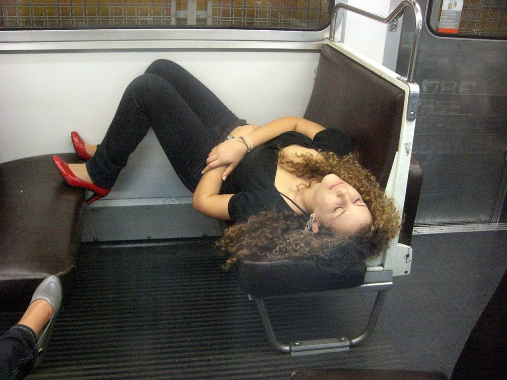 young woman sleeping in the subway